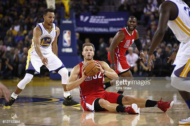 Blake Griffin of the Los Angeles Clippers looks to pass while covered by Stephen Curry of the Golden State Warriors during their preseason game at...