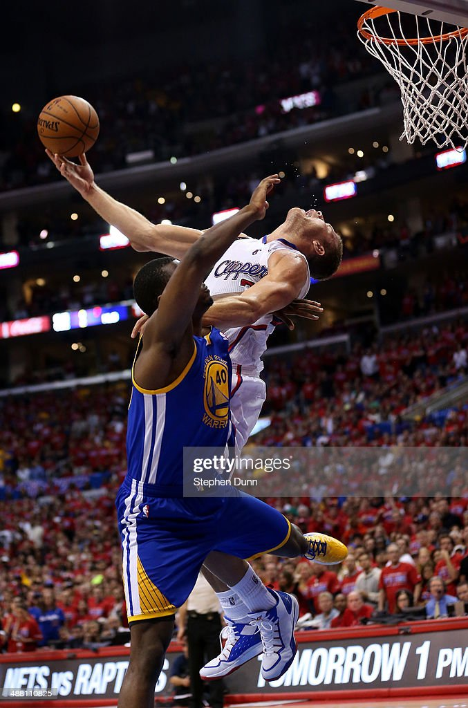 Blake Griffin #32 of the Los Angeles Clippers makes a basket and is fouled by Harrison Barnes #40 of the Golden State Warriors in Game Seven of the Western Conference Quarterfinals during the 2014 NBA Playoffs at Staples Center on May 3, 2014 in Los Angeles, California. The Clippers won 126-121.