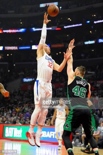 Blake Griffin of the Los Angeles Clippers plays against Aron Baynes of the Boston Celtics on January 24 2018 at STAPLES Center in Los Angeles...