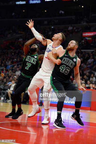 Blake Griffin of the Los Angeles Clippers plays against Jaylen Brown and Aron Baynes of the Boston Celtics on January 24 2018 at STAPLES Center in...