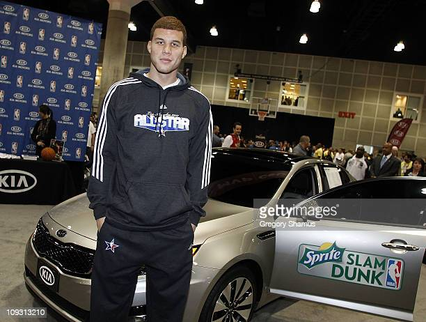 Blake Griffin of the Los Angeles Clippers poses with the Kia Optima he jumped over during Sprite Slam Dunk Contest at Jam Session presented by Adidas...