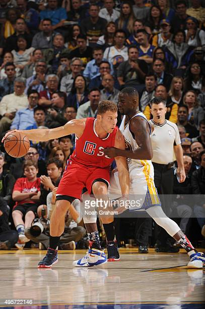 Blake Griffin of the Los Angeles Clippers posts against Draymond Green of the Golden State Warriors on November 4 2015 at Oracle Arena in Oakland...