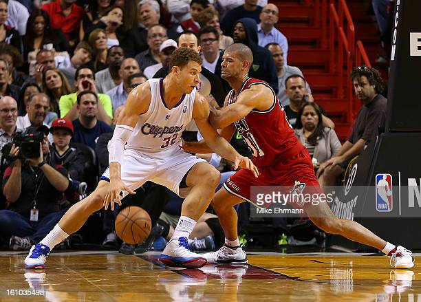 Blake Griffin of the Los Angeles Clippers posts up Shane Battier of the Miami Heat during a game at American Airlines Arena on February 8 2013 in...