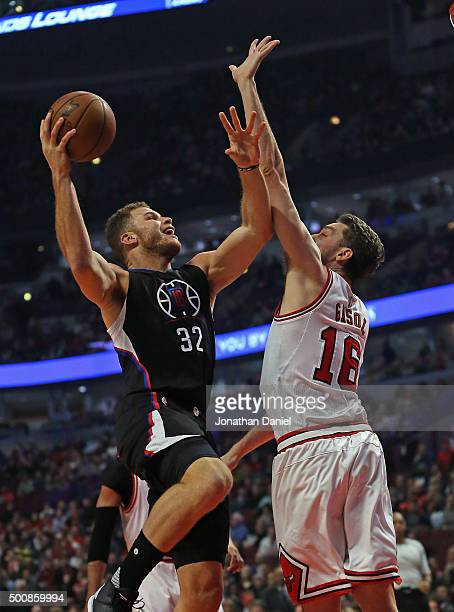 Blake Griffin of the Los Angeles Clippers puts up a shot against Pau Gasol of the Chicago Bulls at the United Center on December 10 2015 in Chicago...