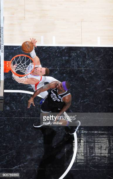 Blake Griffin of the Los Angeles Clippers puts up a shot against Zach Randolph of the Sacramento Kings on January 11 2018 at Golden 1 Center in...