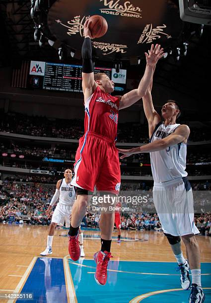 Blake Griffin of the Los Angeles Clippers puts up the hook shot against Yi Jianlian of the Dallas Mavericks on April 2 2012 at the American Airlines...