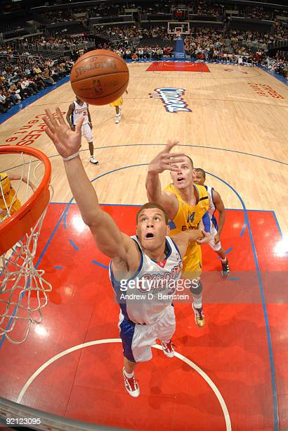 Blake Griffin of the Los Angeles Clippers reaches for a rebound against Maciej Lampe of Maccabi Electra Tel Aviv at Staples Center on October 20 2009...