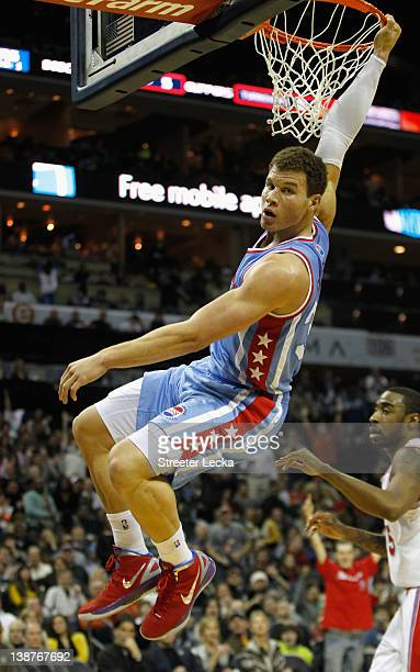 Blake Griffin of the Los Angeles Clippers reacts after dunking the ball on the Charlotte Bobcats during their game at Time Warner Cable Arena on...