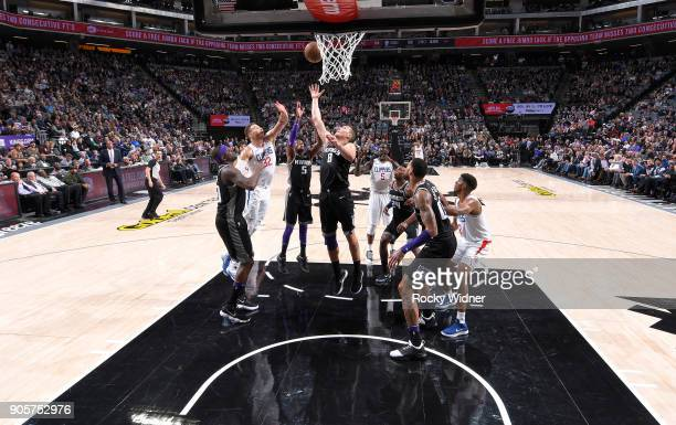 Blake Griffin of the Los Angeles Clippers rebounds against Bogdan Bogdanovic of the Sacramento Kings on January 11 2018 at Golden 1 Center in...