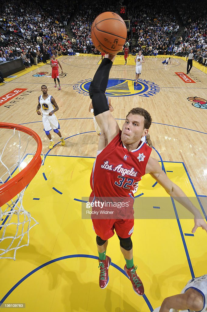 Blake Griffin #30 of the Los Angeles Clippers rises up for a dunk during the season opener against the Golden State Warriors on December 25, 2011 at Oracle Arena in Oakland, California.