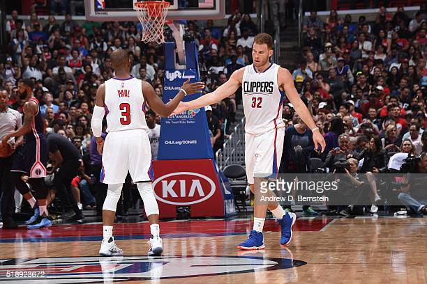Blake Griffin of the Los Angeles Clippers shakes hands with Chris Paul of the Los Angeles Clippers during the game against the Washington Wizards on...
