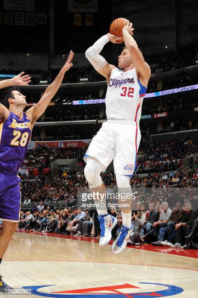 Blake Griffin of the Los Angeles Clippers shoots a jumper against Jason Kapono of the Los Angeles Lakers at Staples Center on December 21 2011 in Los...