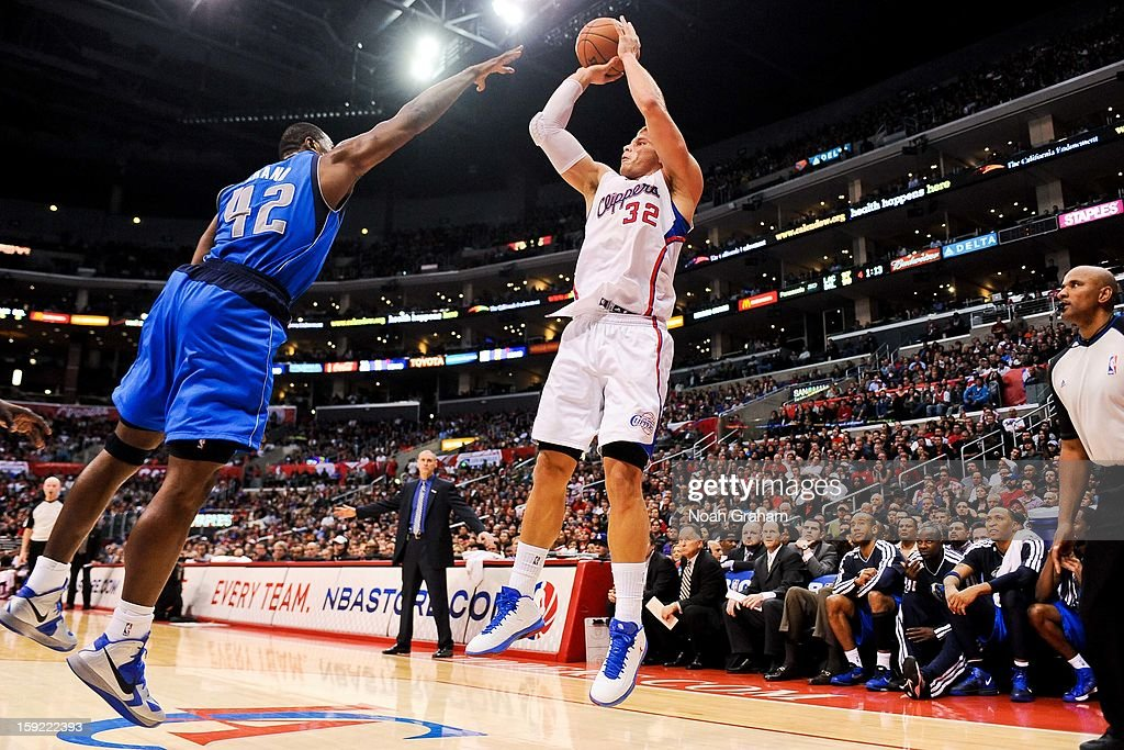 Blake Griffin #32 of the Los Angeles Clippers shoots against Elton Brand #42 of the Dallas Mavericks at Staples Center on January 9, 2013 in Los Angeles, California.
