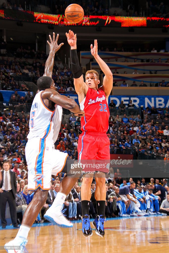 Blake Griffin #32 of the Los Angeles Clippers shoots against Kendrick Perkins #5 of the Oklahoma City Thunder on November 21, 2012 at the Chesapeake Energy Arena in Oklahoma City, Oklahoma.