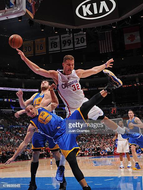 Blake Griffin of the Los Angeles Clippers shoots against Stephen Curry of the Golden State Warriors at Staples Center on March 12 2014 in Los Angeles...