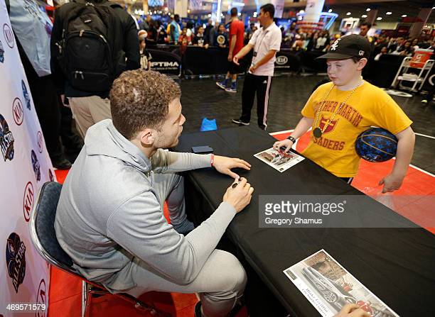 Blake Griffin of the Los Angeles Clippers signs autographs at the Kia MVP court during the 2014 NBA AllStar Jam Session at the Ernest N Morial...