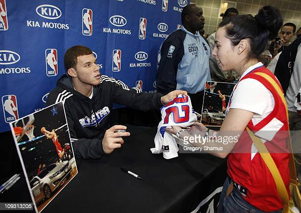 Blake Griffin of the Los Angeles Clippers signs autographs during a Kia Motors appearance at Jam Session presented by Adidas during NBA All Star...