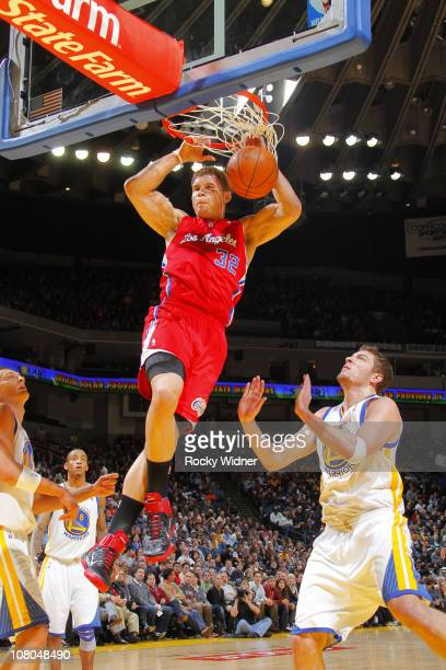 Blake Griffin of the Los Angeles Clippers soars through the air for a dunk against the Golden State Warriors on January 14 2011 at Oracle Arena in...