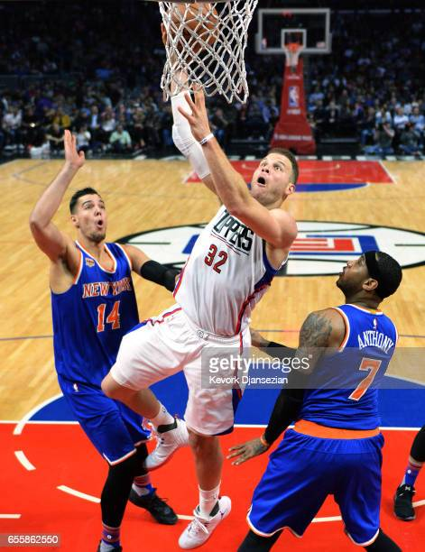 Blake Griffin of the Los Angeles Clippers throws a hook shot over Carmelo Anthony and Willy Hernangomez of the New York Knicks during the first half...