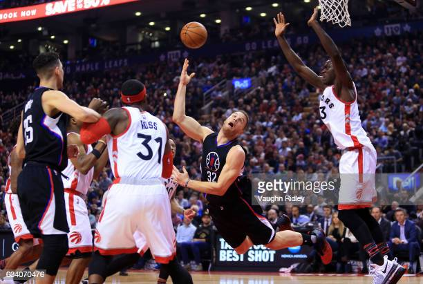 Blake Griffin of the Los Angeles Clippers throws up a shot as Pascal Siakam of the Toronto Raptors defends during the first half of an NBA game at...