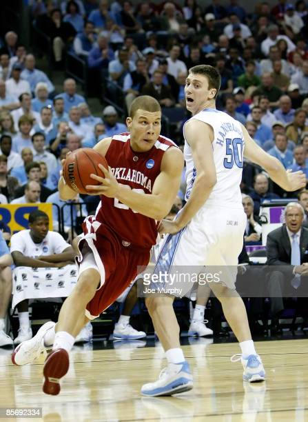 Blake Griffin of the Oklahoma Sooners drives to the basket by Tyler Hansbrough of the North Carolina Tar Heels in the first half during the NCAA...