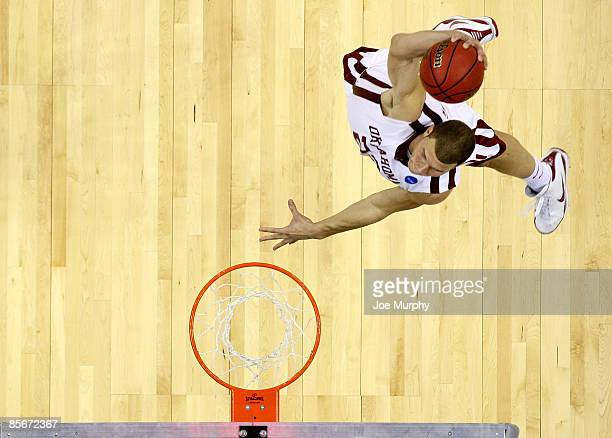 Blake Griffin of the Oklahoma Sooners dunks the ball in the second half against the Syracuse Orange during the NCAA Men's Basketball Tournament South...