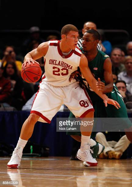 Blake Griffin of the Oklahoma Sooners goes up against Howard Crawford of the UAB Blazers during the pre-season NIT at Madison Square Garden November...