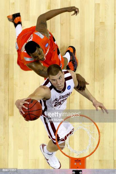 Blake Griffin of the Oklahoma Sooners goes up for a shot in front of Kris Joseph of the Syracuse Orange in the second half during the NCAA Men's...