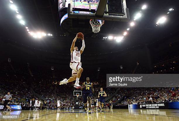 Blake Griffin of the Oklahoma Sooners jumps to the net for a layup against the Michigan Wolverines during the second round of the NCAA Division I...