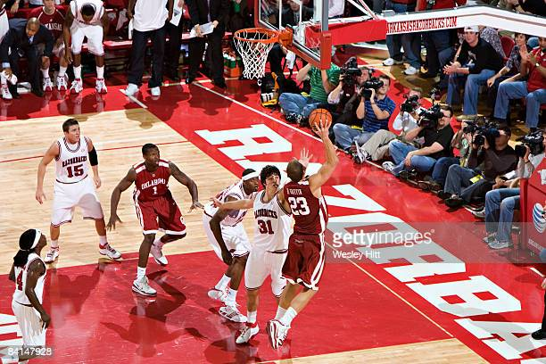 Blake Griffin of the Oklahoma Sooners shoots a hook shot over Michael Sanchez of the Arkansas Razorbacks at Bud Walton Arena on December 30, 2008 in...