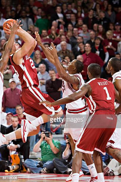 Blake Griffin of the Oklahoma Sooners shoots a jump shot under pressure against the Arkansas Razorbacks at Bud Walton Arena on December 30, 2008 in...