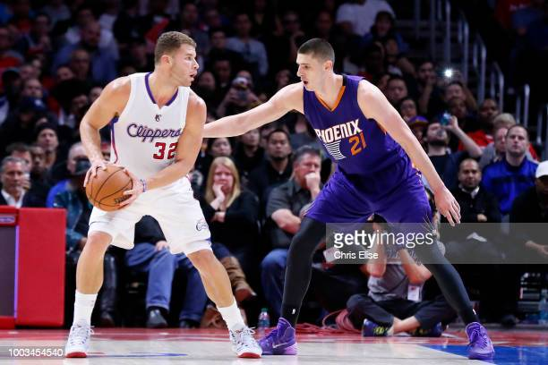 Blake Griffin of the the LA Clippers handles the ball against Alex Len of the Phoenix Suns on December 8 2014 at STAPLES Center in Los Angeles...