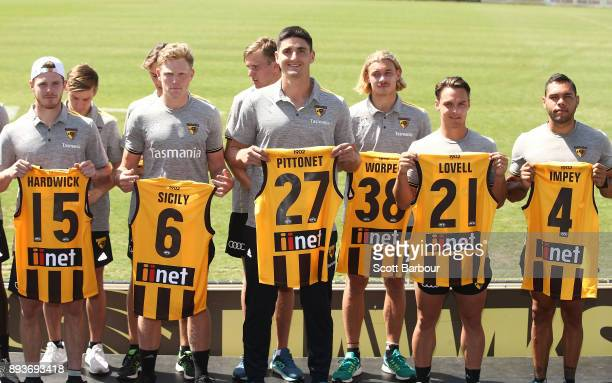 Blake Hardwick James Sicily Marc Pittonet James Worpel Kieran Lovell and Jarman Impey of the Hawks hold their new guernsey numbers at the jumper...
