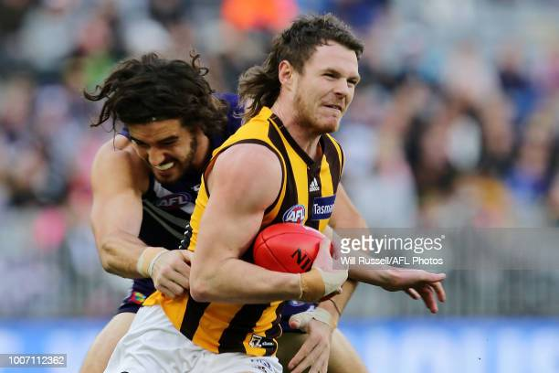Blake Hardwick of the Hawks fends off Alex Pearce of the Dockers during the round 19 AFL match between the Fremantle Dockers and the Hawthorn Hawks...