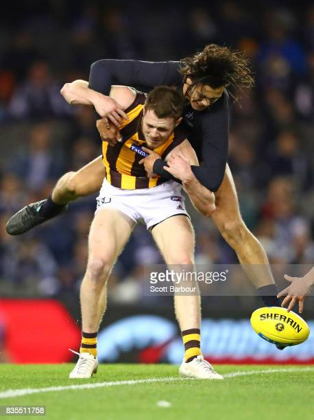Blake Hardwick of the Hawks is tackled by Jack Silvagni of the Blues during the round 22 AFL match between the Carlton Blues and the Hawthorn Hawks...
