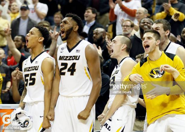 Blake Harris Kevin Puryear and Cullen VanLeer of the Missouri Tigers react from the bench after the Tigers scored during the game against the Stephen...