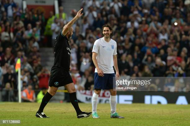 Blake Harrison smiles as Eric Cantona waves to the crowd during Soccer Aid for Unicef 2018 at Old Trafford on June 10 2018 in Manchester England