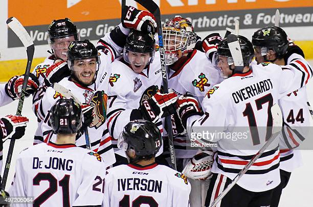Blake Heinrich Paul Bittner and goaltender Adin Hill of the Portland Winterhawks celebrate their teams win over the Vancouver Giants after their WHL...