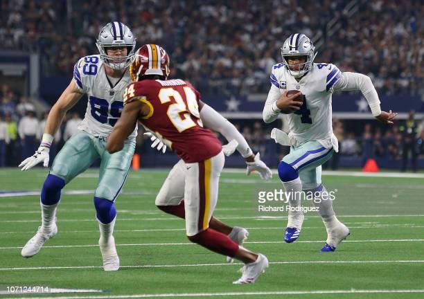 Blake Jarwin of the Dallas Cowboys blocks Josh Norman of the Washington Redskins for Dak Prescott of the Dallas Cowboys in the fourth quarter at ATT...