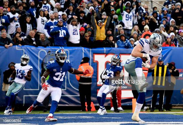Blake Jarwin of the Dallas Cowboys catches a pass in the end zone to score a touchdown during the first quarter of the game against the New York...