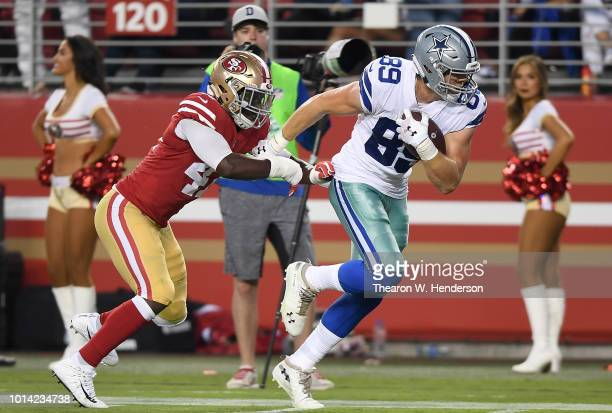 Blake Jarwin of the Dallas Cowboys fights off the tackle of Elijah Lee of the San Francisco 49ers to take the ball down to the one yard line in the...