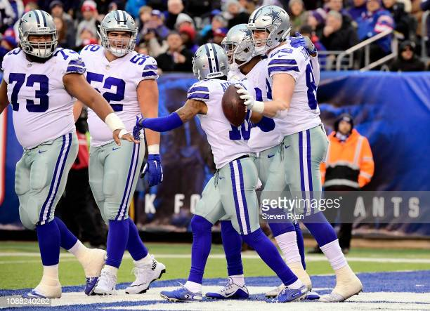Blake Jarwin of the Dallas Cowboys is congratulated by his teammates after his third quarter touchdown against the New York Giants at MetLife Stadium...