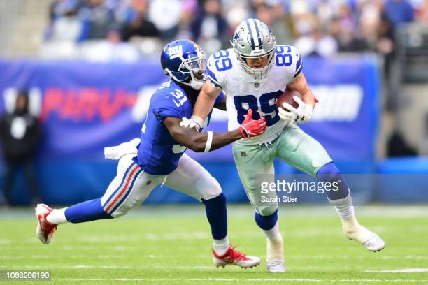 Blake Jarwin of the Dallas Cowboys is tackled by Michael Thomas of the New York Giants during the first quarter of the game at MetLife Stadium on...