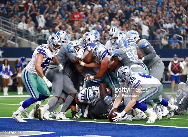 Blake Jarwin of the Dallas Cowboys recovers a fumble short of the goal line in the third quarter of a game against the Detroit Lions at ATT Stadium...
