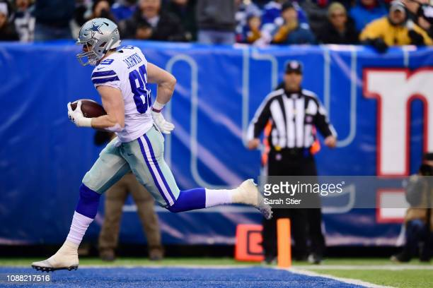 Blake Jarwin of the Dallas Cowboys runs into the end zone for a touchdown during the third quarter of the game against the New York Giants at MetLife...