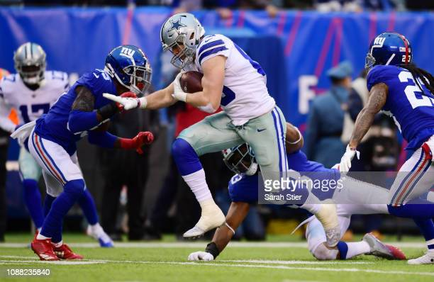 Blake Jarwin of the Dallas Cowboys runs toward the end zone to score a touchdown during the third quarter of the game against the Dallas Cowboys at...