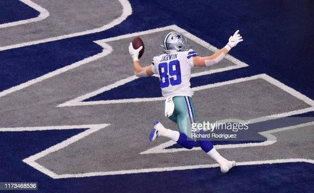 Blake Jarwin of the Dallas Cowboys scores a touchdown in the first quarter against the New York Giants at ATT Stadium on September 08 2019 in...