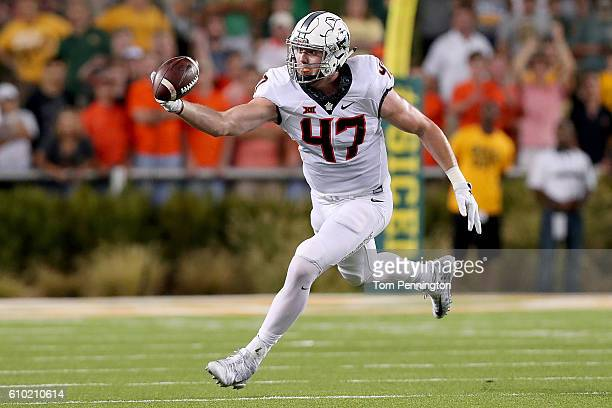 Blake Jarwin of the Oklahoma State Cowboys bobbles a pass against the Baylor Bears in the first half at McLane Stadium on September 24 2016 in Waco...