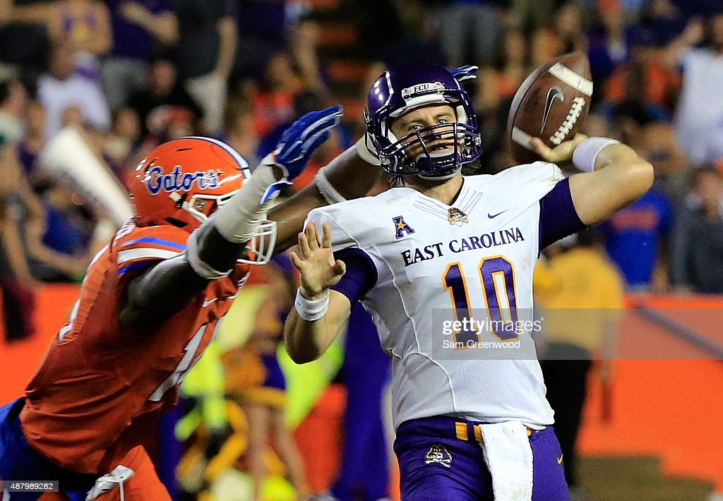 Blake Kemp #10 of the East Carolina Pirates attempts a pass during the game against the Florida Gators at Ben Hill Griffin Stadium on September 12, 2015 in Gainesville, Florida.
