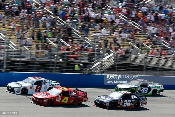 Blake Koch driver of the AQUAhydrate Toyota leads a pack of cars during the NASCAR XFINITY Series Drive4Clotscom 300 at Auto Club Speedway on March...